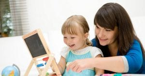 laughing child and teacher at preschool