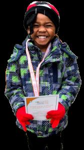 girl holding sign at preschool