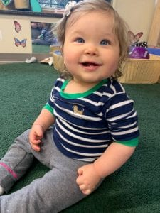 happy infant at preschool