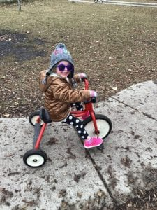 preschooler on tricycle at daycare