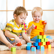 boys playing with blocks at preschool