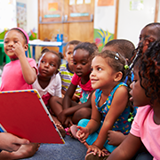 girls learning to read at daycare