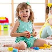 preschool girl with toy