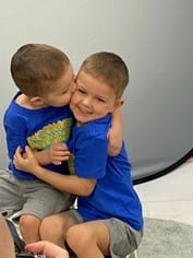 children hugging at preschool