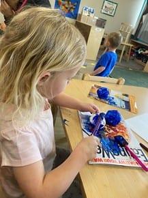 child drawing on eathday at preschool