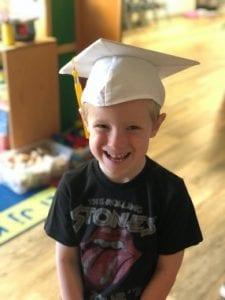 child graduating at preschool